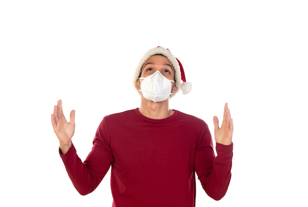 African guy wearing a christmas hat and a mask isolated on a white background Premium Photo