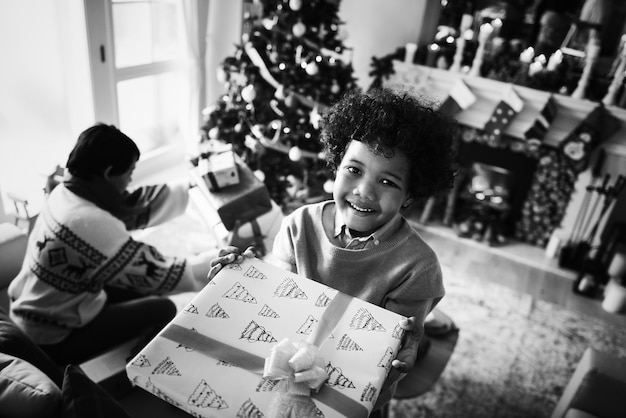 African kid holding a christmas present