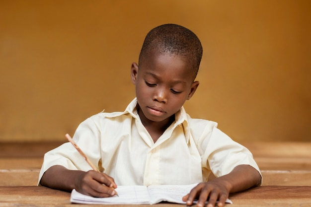 African kid learning in class