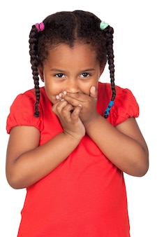 African little girl covering the mouth isolated on a over white