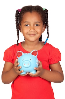 African little girl with a blue piggy-bank isolated on a over white