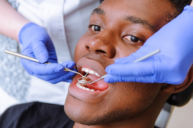 African male patient getting dental treatment in dental clinic