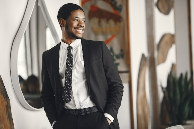 African man in a black suit.