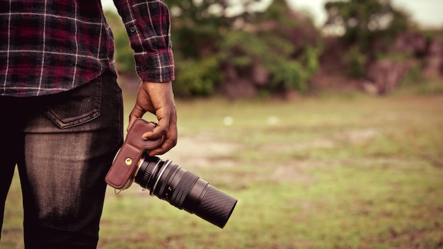 African man photograpy holding the camera