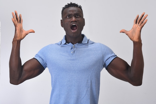 African man shouting with arms raised