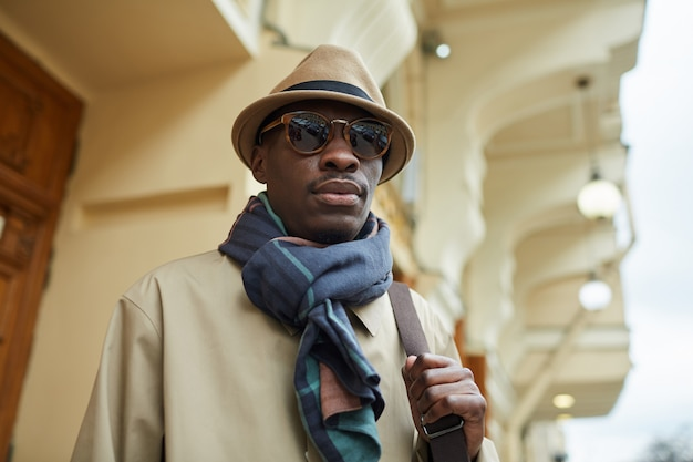 African man wearing trench coat