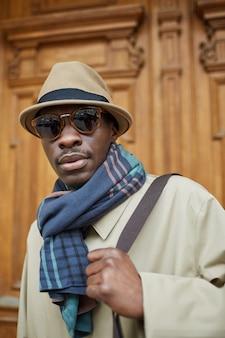 African man wearing trenchcoat