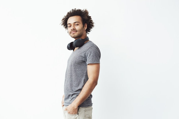 African man with headphones smiling