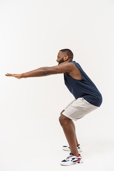African sport man exercising and stretching on white