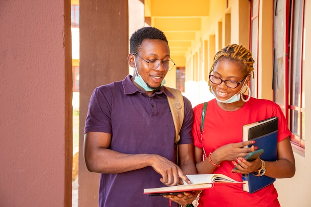 African students studying together on campus, wearing face mask