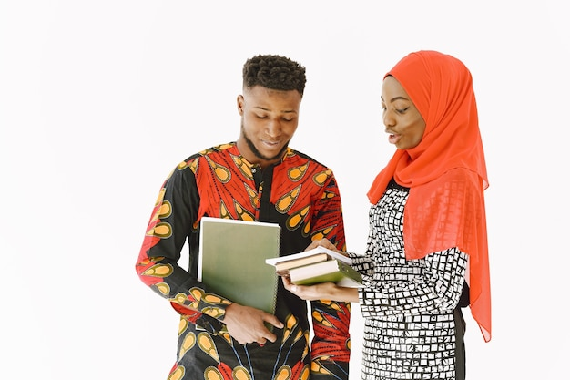 African students. young people in traditional nigerian clothes. holding books. study concept.