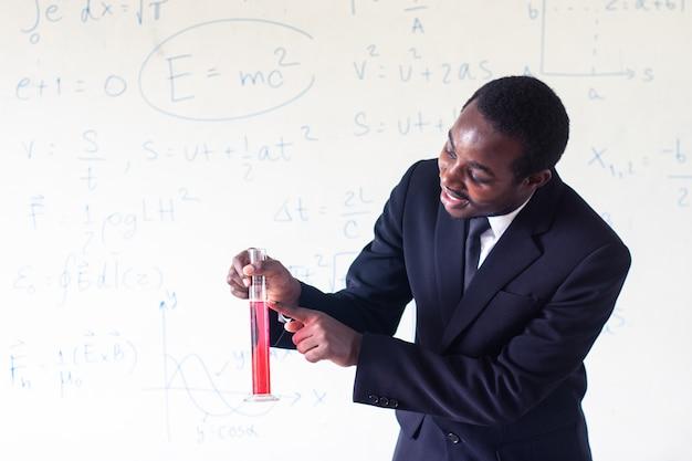 African teacher teaching science in the stem class.