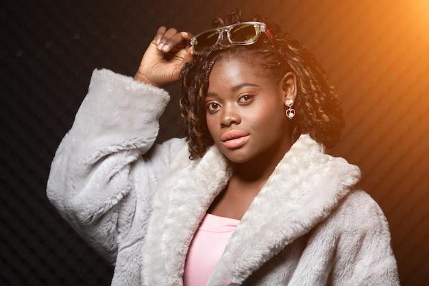 African teenager woman tan skin black afro hair