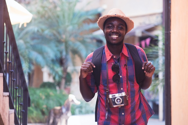 African traveler man travel in the city with smile and happy.