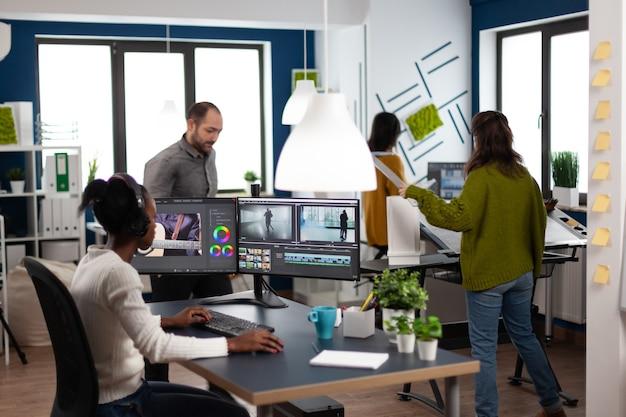 African video editor wearing headset editing design movie