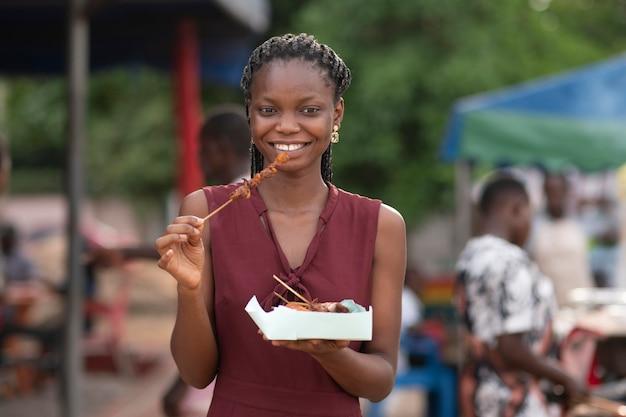 African woman eating street food