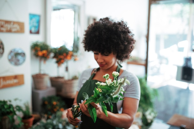 Afro african woman holding bunch of flowers