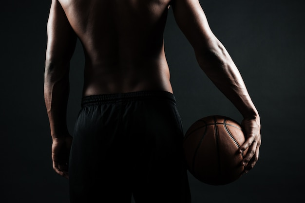 Afro american basketball player, holding ball