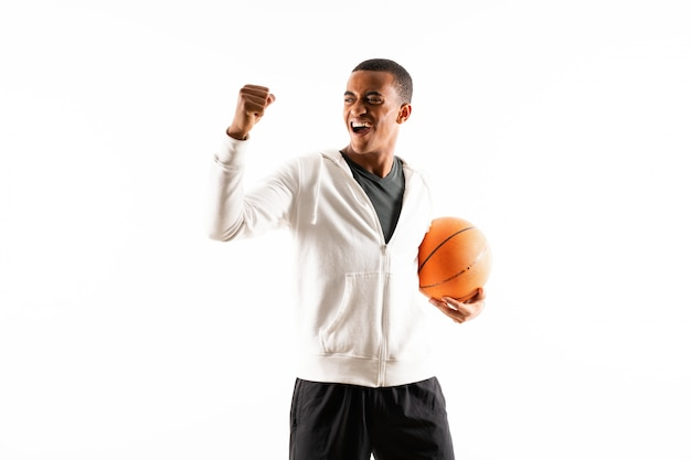 Afro american basketball player man over isolated white