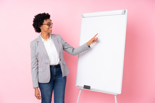 Afro american business woman  over pink wall