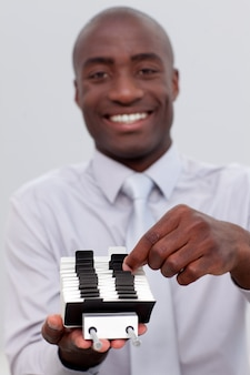 Afro-american businessman looking at an index holder