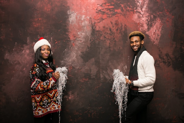 Afro american couple with confetti