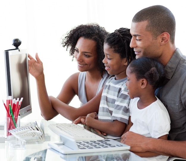 Afro-american family working with a computer at home