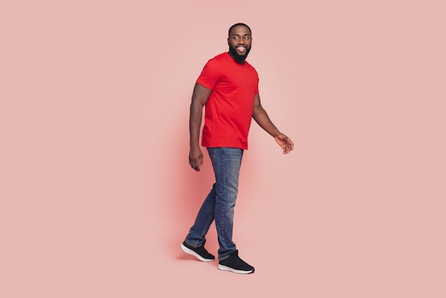 Afro american guy go empty space pink color background