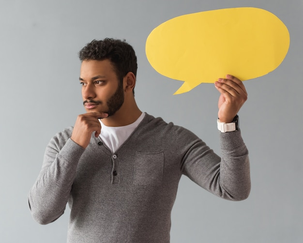 Afro american guy holding a speech bubble