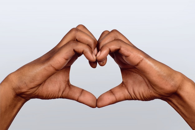 Afro american hand make heart shape.