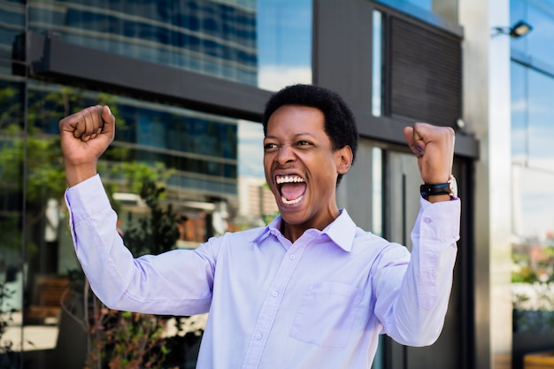 Afro american man celebrating success.