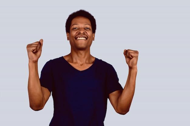 Afro american man celebration victory.