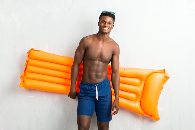 Afro american man enjoying summer vacation with float