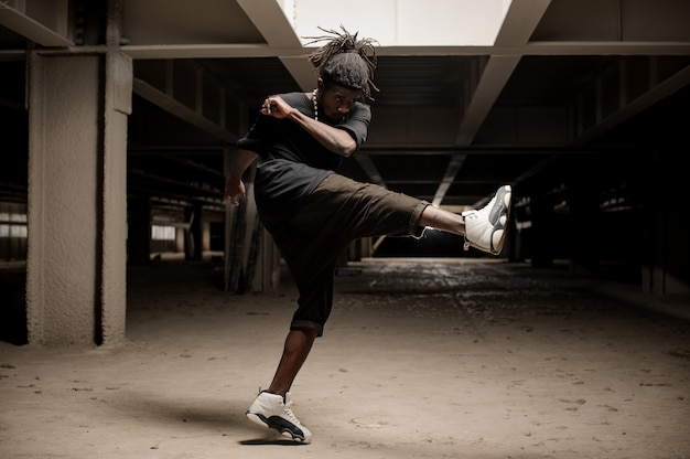 Afro american man lifting the leg up