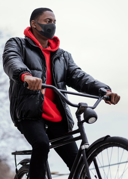 Afro-american man riding his bicycle