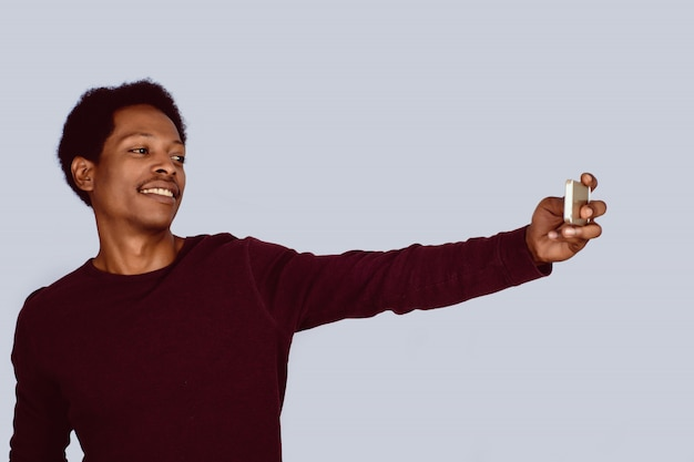 Afro american man taking selfie on studio.