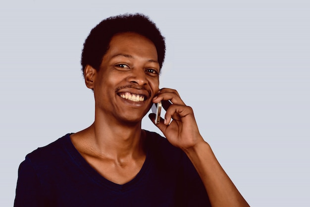 Afro american man talking on phone.