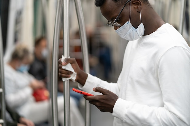 Afro american man wear face mask in public transportation during covid pandemic