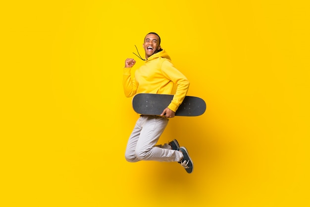 Afro american skater man over isolated white