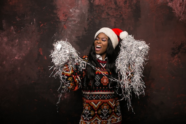 Afro american woman on a christmas party with confetti