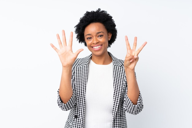 Afro american woman showing number eigt with fingers raised isolated