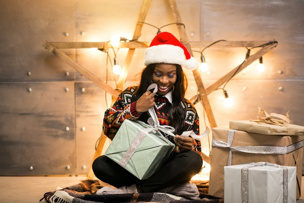 Afro american woman unpacking christmas presents