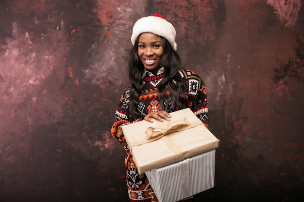Afro american woman with christmas presents