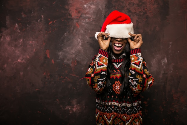 Afro american woman with a red hat on christmas