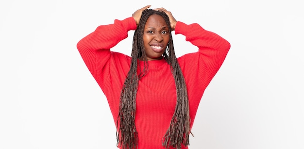 Afro black adult woman feeling frustrated and annoyed, sick and tired of failure, fed-up with dull, boring tasks