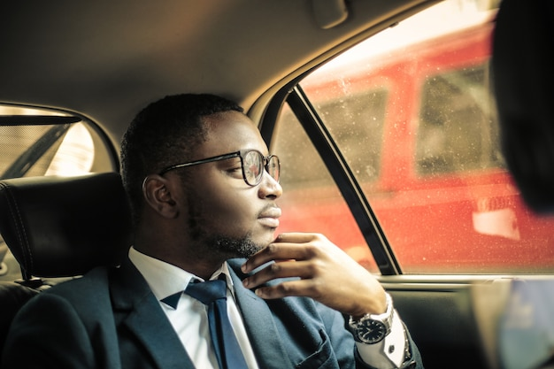 Afro businessman in a car
