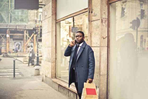 Afro businessman talking on the phone