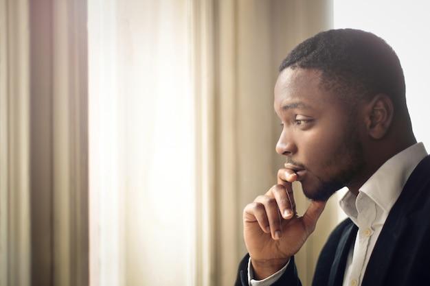 Afro businessman wondering