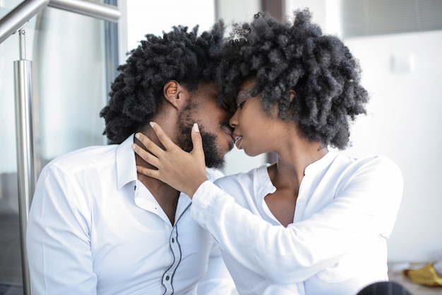 Afro couple kissing