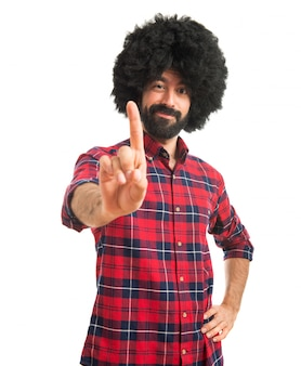 Afro man counting one